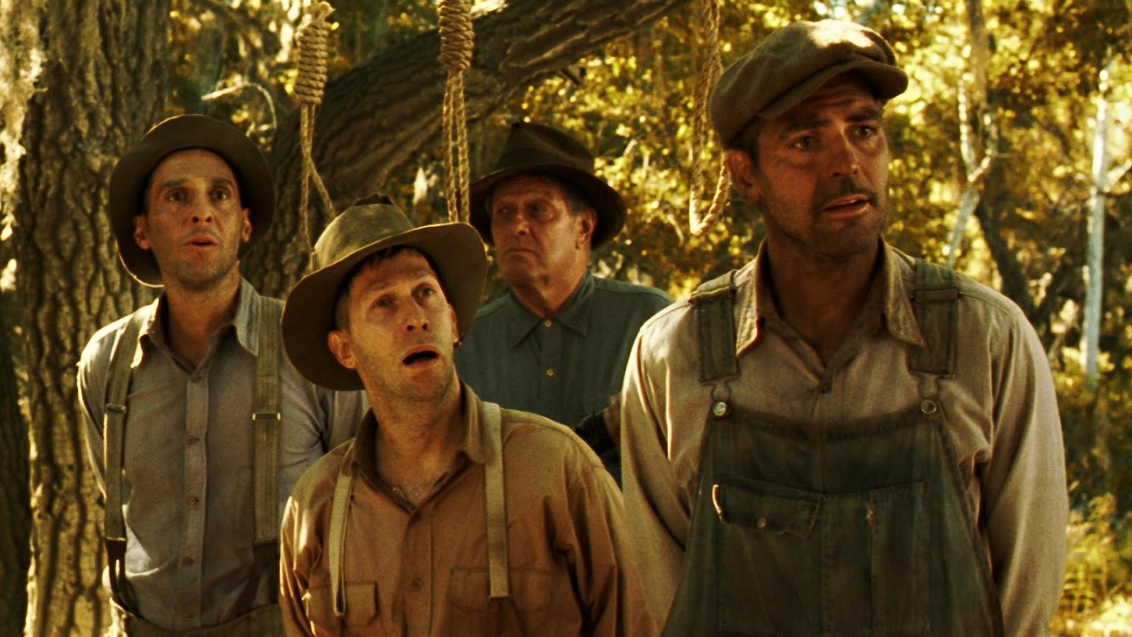 Detentos são interpretados por George Clooney, Tim Blake Nelson e John Turturro (Foto: Reprodução)